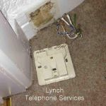 damaged-telephone-wall-extension